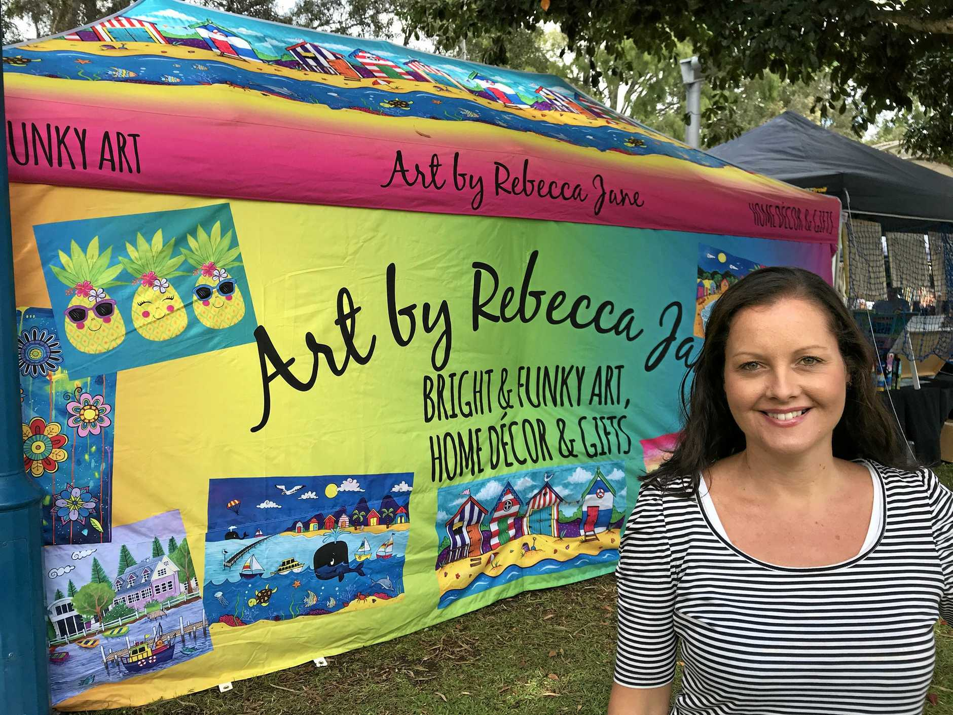 Rebecca Jane Knowles with her funky art tent at the Urangan Pier Markets.