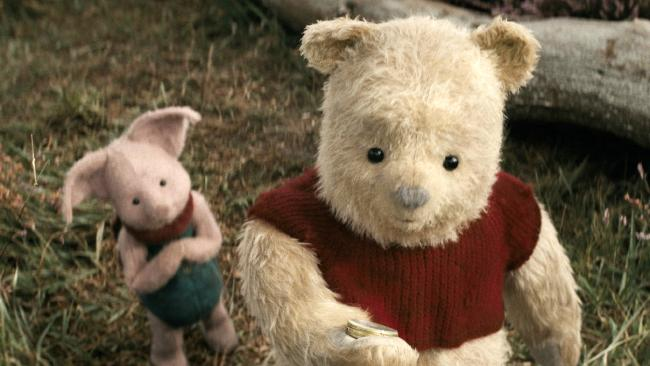 This image released by Disney shows characters Piglet, left, and Pooh in a scene from Christopher Robin. Picture: Laurie Sparham/Disney