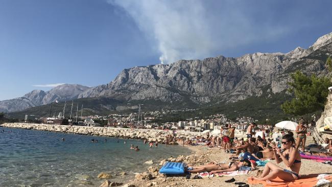 Tourists flock to a private beach in Makarska. Picture: Rhian Deutrom