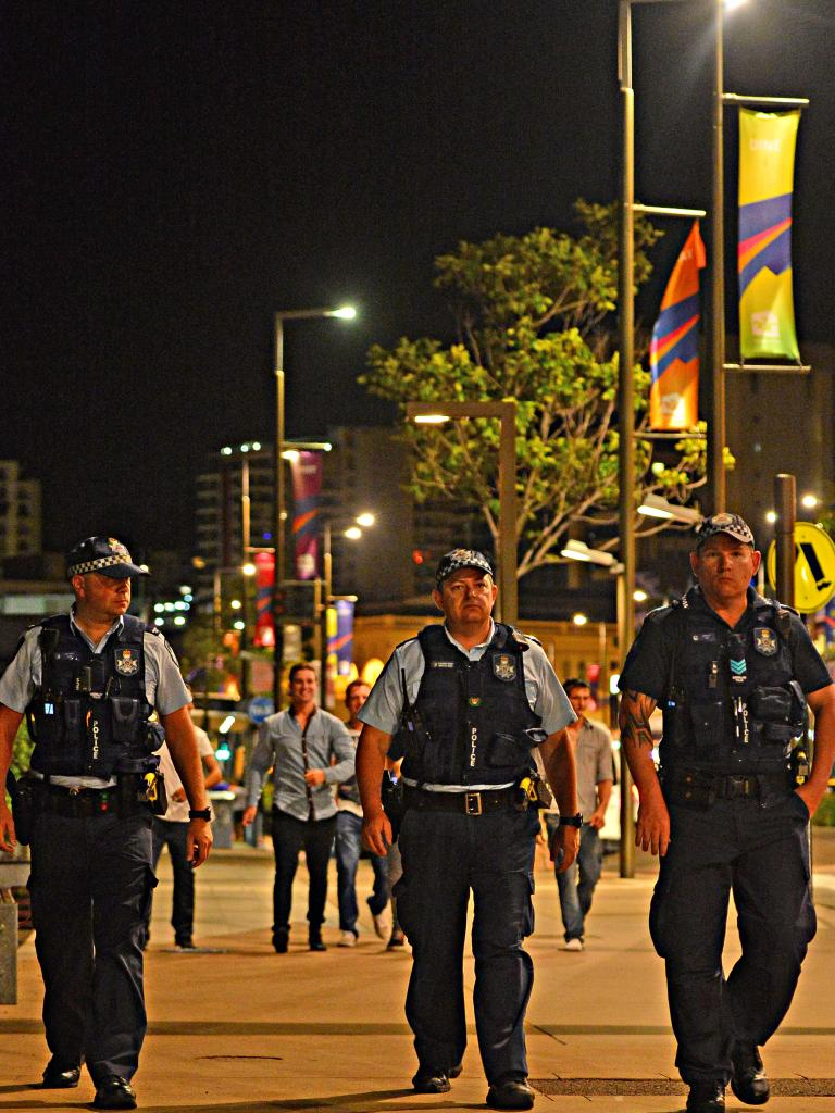 Townsville police walk down Flinders Street East's Drink Safe Precinct. Picture: Zak Simmonds