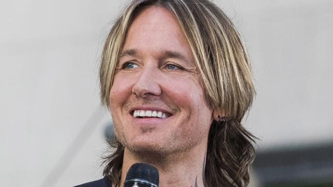 Caught short: A generous grandmother picked up the bill when Keith Urban was caught short a few dollars at a service station. Picture: Charles Sykes/Invision/AP