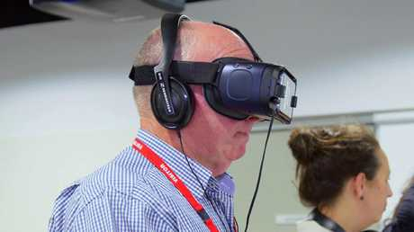 Doug Wood using the virtual reality technology which allows him a glimpse into the life of his wife Katie, who lives with dementia. Picture: Dementia Australia