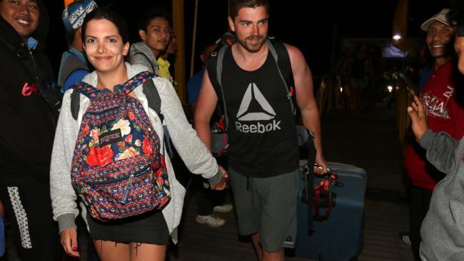 Australian Giovanna Ferraioli (L) and her partner Damien La Cava part of tourist evacuate from Gili Trawangan in Lombok to Bali. Picture: Lukman S Bintoro