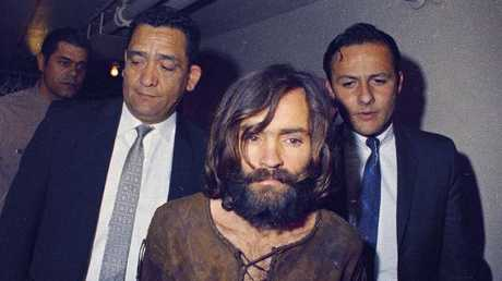 Charles Manson being escorted to his arraignment on conspiracy-murder charges in connection with the Sharon Tate murder case in 1969.