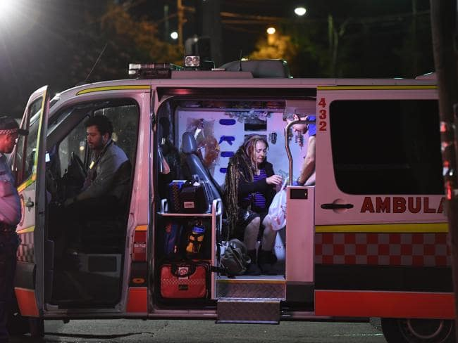 Victim Sharon Hacker in an ambulance after her attack by Evie Amati's whose second axe blow could have killed. Picture: Gordon McComiskie