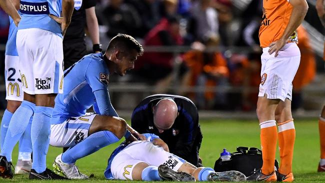 Luke Brattan lays prone after the incident. Picture: Getty