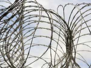 Townsville prison guard charged with assault