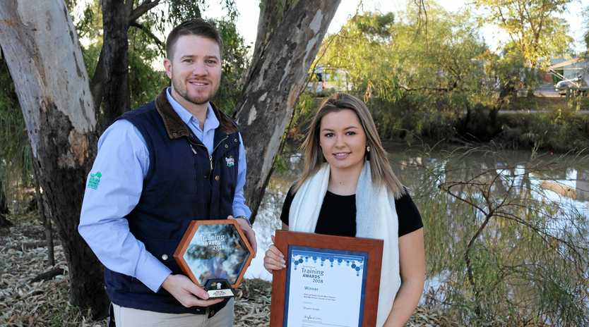 WINNERS: SunPork Farms Operations Manager Rob Martyn and Western Downs Regional Council employee Shyann Doyle were thrilled to be recognised at the Regional Queensland Training Awards last week.