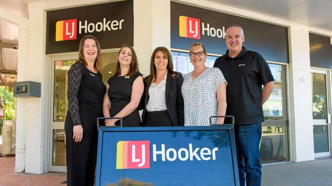 GROWING: Andrea Pilch, Hannah Gannon, owner Christina Nipperess, Michelle Smith and Mathew Clark outside the new LJ Hooker Iluka office.