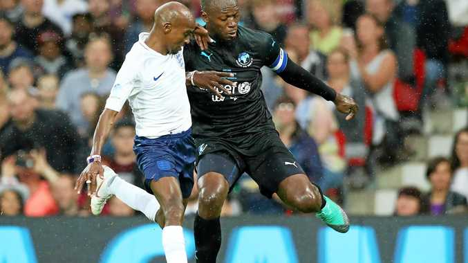 Usain Bolt, playing for the Rest of the World, and England's Sir Mo Farah battle for the ball during the Soccer Aid for UNICEF match at Old Trafford on June 10. Picture: Lynne Cameron/Getty