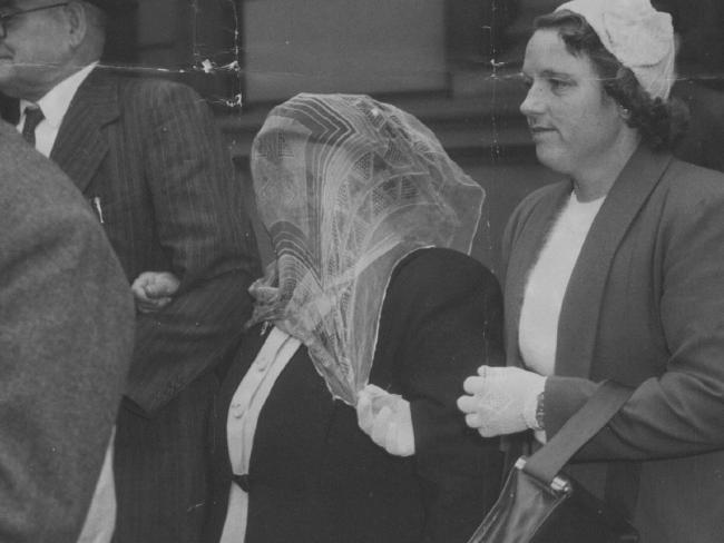 A veiled Grills is escorted to court for her trial. Picture: News Corp