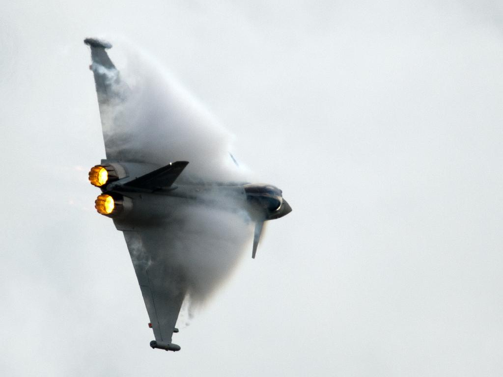 A Eurofighter Typhoon, a twin-engine multi role fighter banks during a flying display. A Spanish Typhoon has accidentally fired an AMRAAM missile. Picture: AFP
