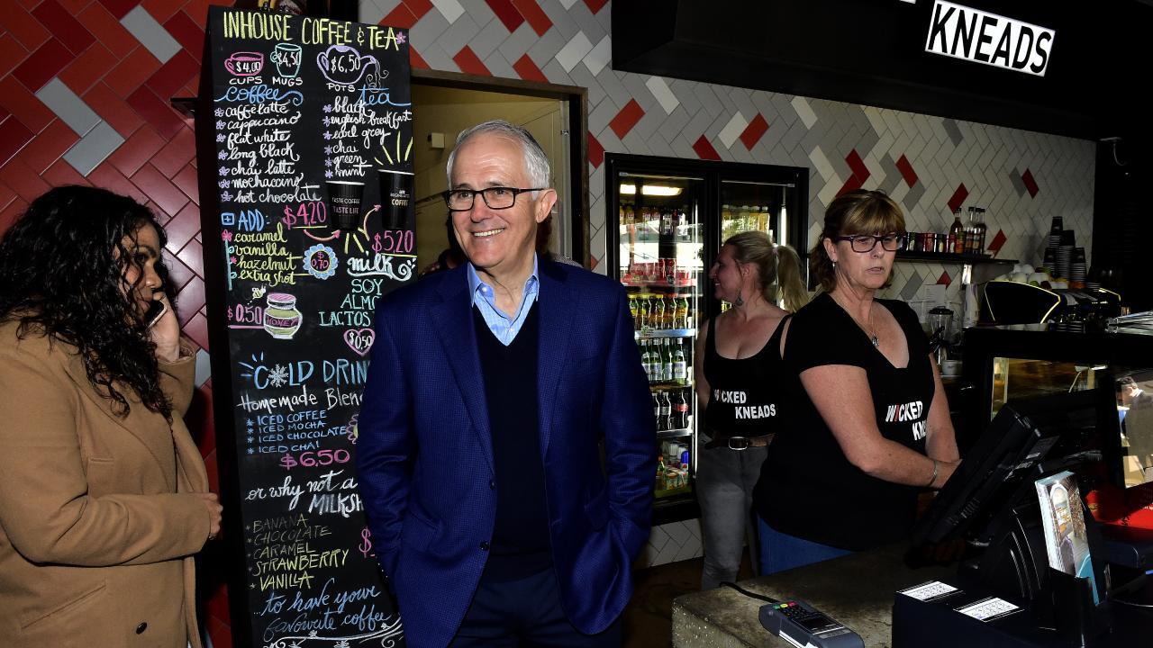 Prime Minister Malcolm Turnbull and Country Liberal party candidate for Ligiari Jacinta Price (left) at Wicked Kneads Bakery in Alice Springs. Picture: AAP/Chloe Erlich