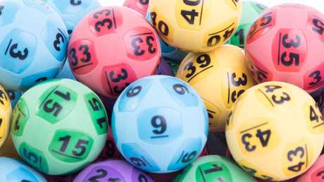 NSW man claims his $35 million share of the $70 million Oz Lotto jackpot, but the hunt is on for the Victorian entry who is yet to claim their share.