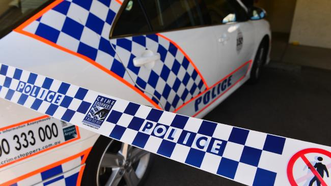 One man is on the run following a home invasion and police pursuit