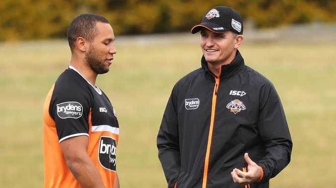 Wests Tigers coach Ivan Cleary talks with Moses Mbye on Wednesday. Picture: Brett Costello