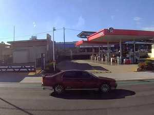 WATCH: Car runs red light in Toowoomba, nearly hits truck
