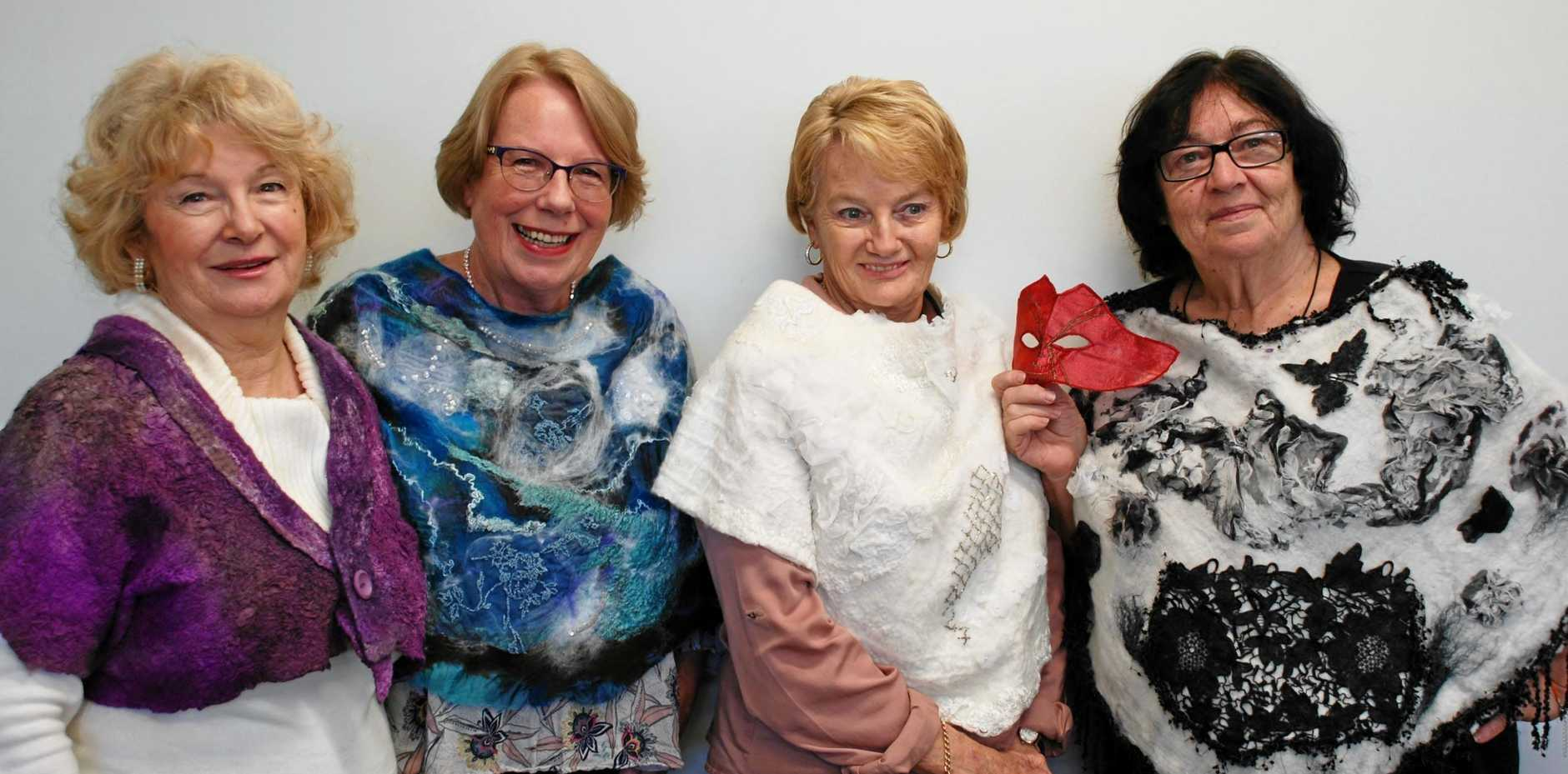 WILD ABOUT TEXTILES: Patti McCandless, Helen Basch, Eileen Taylor, Mitzi Ruzicka show off their felted capelets, just some of the many diverse pieces on show as part of the Wild Women Textile Journeys through Colour, Stitch and Texture exhibition at Robina Community Centre Art Gallery from September 12-23.