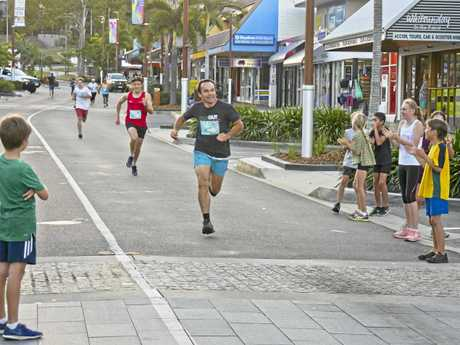 Adults men and women open race at the Whitsunday Reef Festival Magic Mile down the main street of Airlie Beach Saturday evening