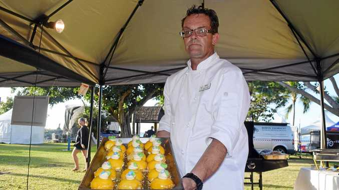 FESTIVAL TREAT: Chef Bradley Martin with mango and bauple nut cheesecakes.