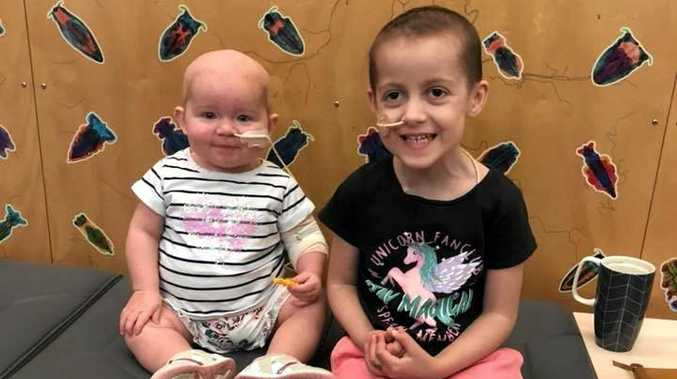 LITTLE TROOPERS: Baby Mia Depuit and Kitty Wilson met at Lady Cilento Children's Hospital for the first time on July 31.