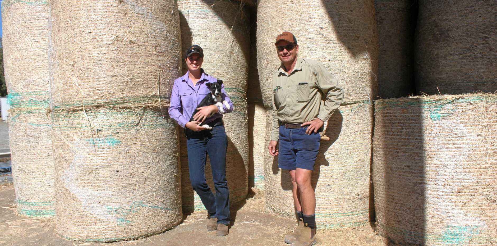 MAKING HAY: Owner John Heid and manager Silvia Tramontin have been busy keeping up with the demand for hay and lucerne in NSW and western Queensland.