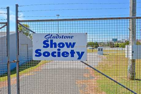 The show society has been locked in a dispute with council regarding using the showgrounds as a fee collecting caravan park.