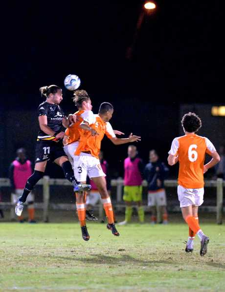 Magpies Crusaders' Kyle Markham flies for a header in the NPL Qld round 23 match against Brisbane Roar Youth.