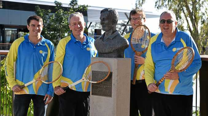 Cressy Tennis Club members (from left) Jason Giddy, Roy Pidgeon Warren Acutt and Peter Lawrence send birthday wishes to the legendary Rod Laver at his bust on Rockhampton's riverbank.