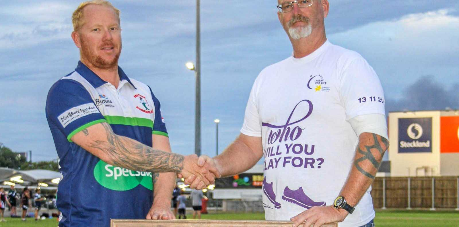RAFFLE ON: Bundaberg Brothers Junior Rugby League President Bryce Holdsworth and 2018 Bundaberg Face of Relay Michael McGaw with the framed Queensland jersey.