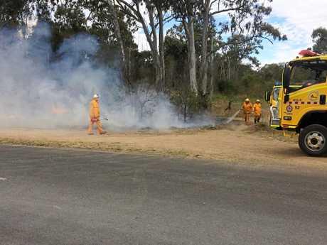 FIRE DANGER: Rural firefighters battling a blaze at East Deep Creek on Wednesday.