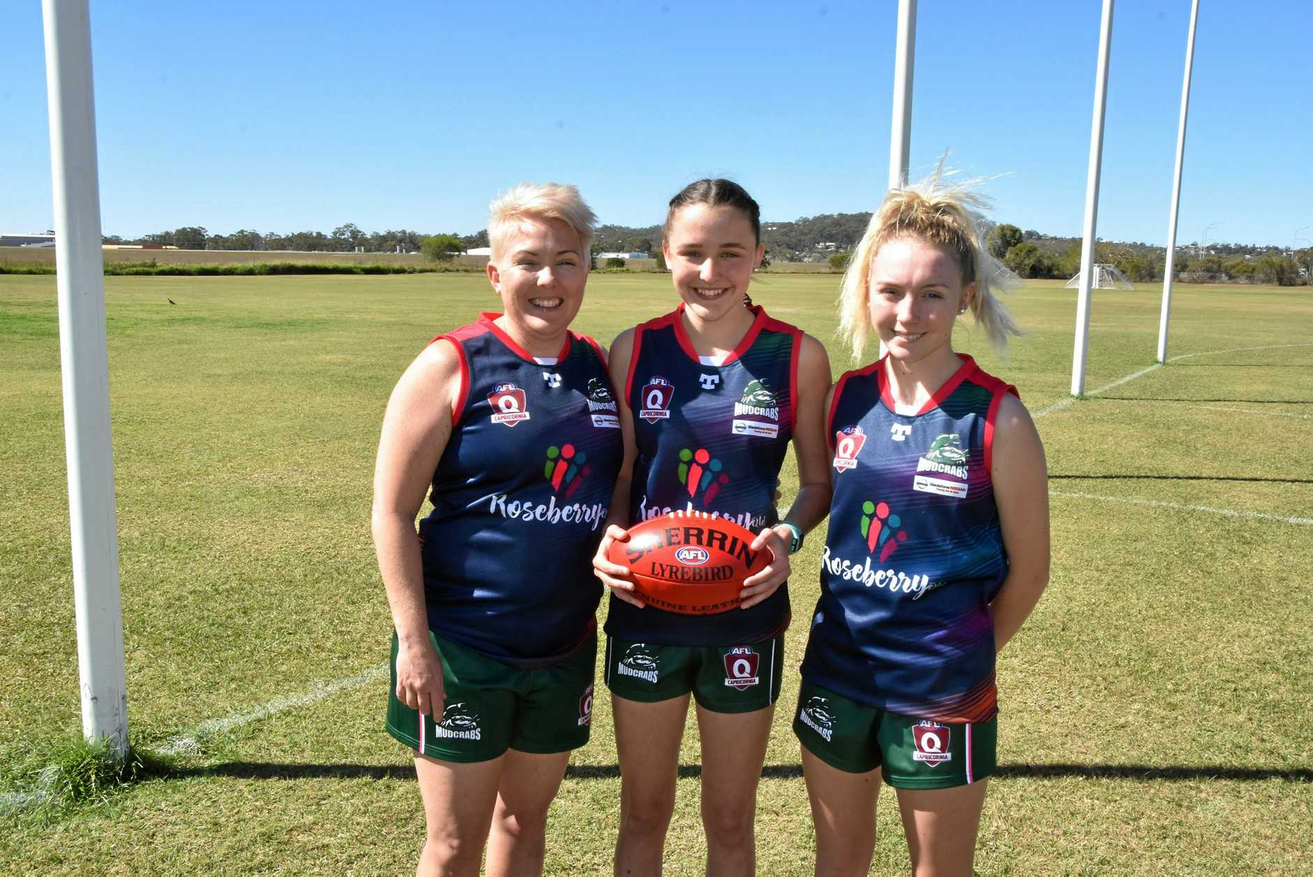 SPORTING FUN: Hayley, Kaila and Emily Kirkwood strongly recommend mums and daughters get together and take on AFLW.