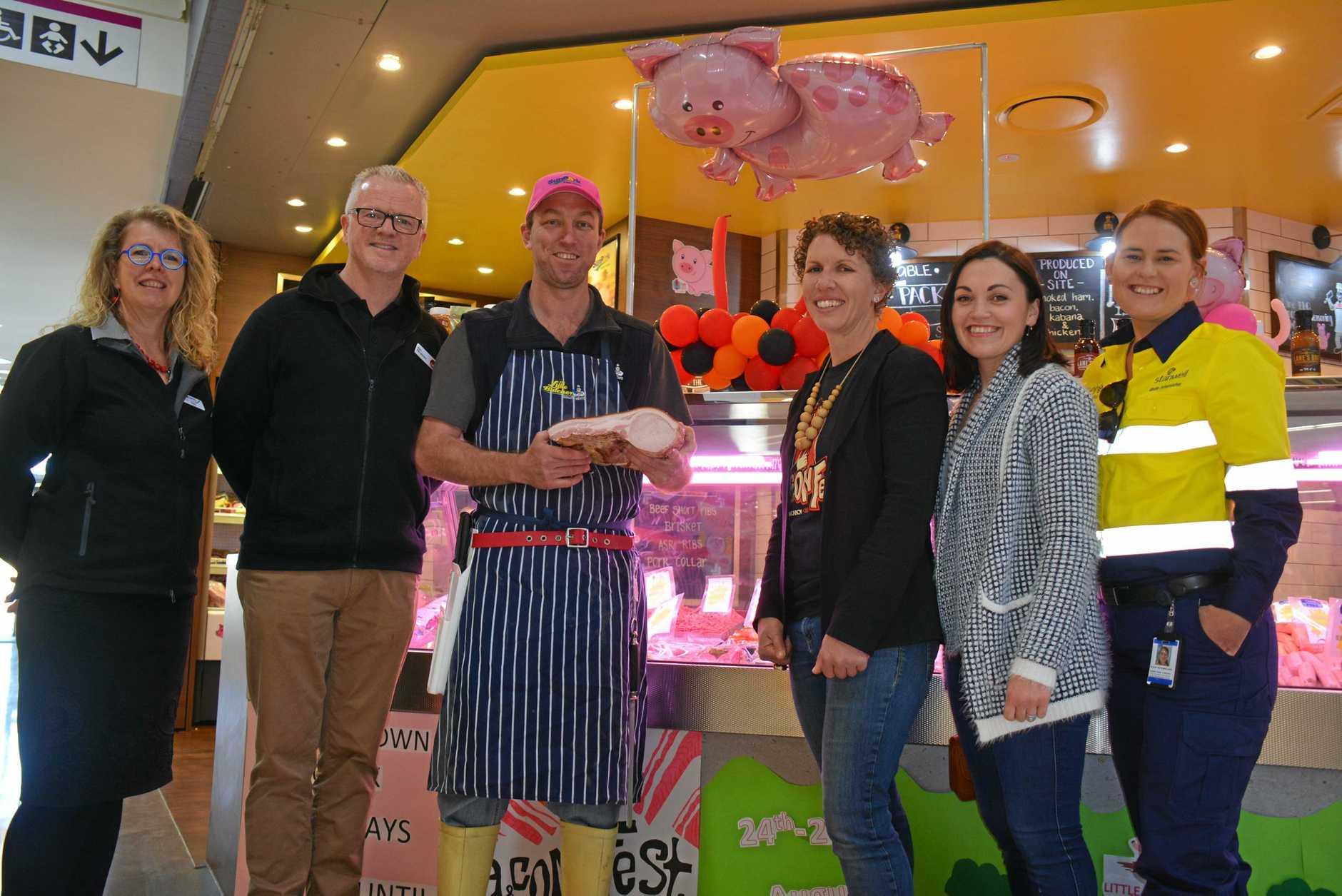 WINNING CUT: Tonia Gilbert, Rob Fitz-Herbert, Clinton Stretton, Kath Stevens, Felicity Cavill and Kirstie Schumacher outside Kingaroy Little Butcher's winning BaconFest shop front.