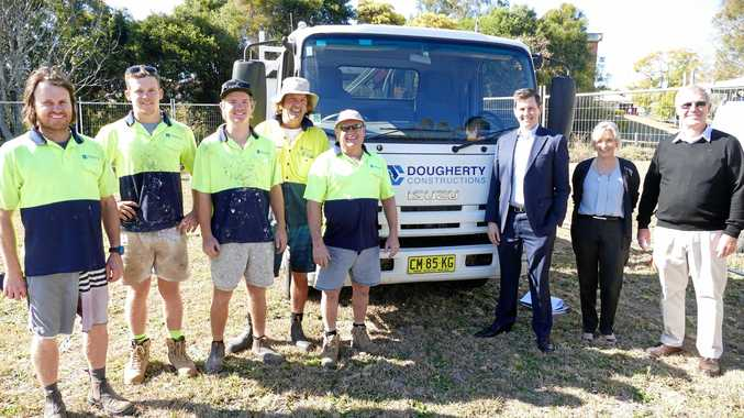 THEY DIG IT: Paul Dougherty and his construction team with Clarence Village CEO Duncan McKimm, Dougherty Villa facility manager Charmaine Want and Clarence Village chairman Geoff Shepherd on the site of the extensions in Arthur St, Grafton.