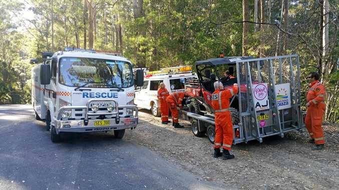 The State Emergency Service's all-terrain rescue vehicle has now retrieved the injured rider who was lying some distance from the roadway.