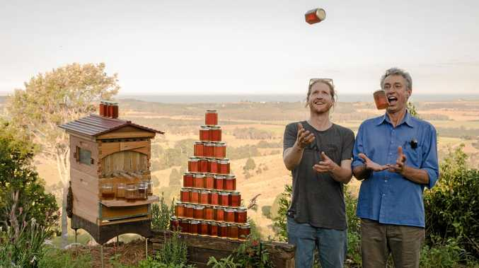 Cedar and Stu Anderson with a western red cedar Flow Hive in the backyard of the Bee Inventive office near Byron Bay