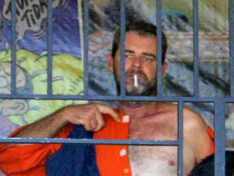 EMBARGO - NO NEWS.COM, NO AUSTRALIAN, NO PERTH NOW, NO SKY NEWS. Australian Brendon Luke Johnsson, 45 arrested in Kuta for allegedly drug dealing. Evidence of 13 cocaine packets was displayed to the media. Brendon had lived in Bali for four years.He is pictured having a smoke in his prison before being presented to the mediaPicture: Zul Edoardo/ News Corp Australia