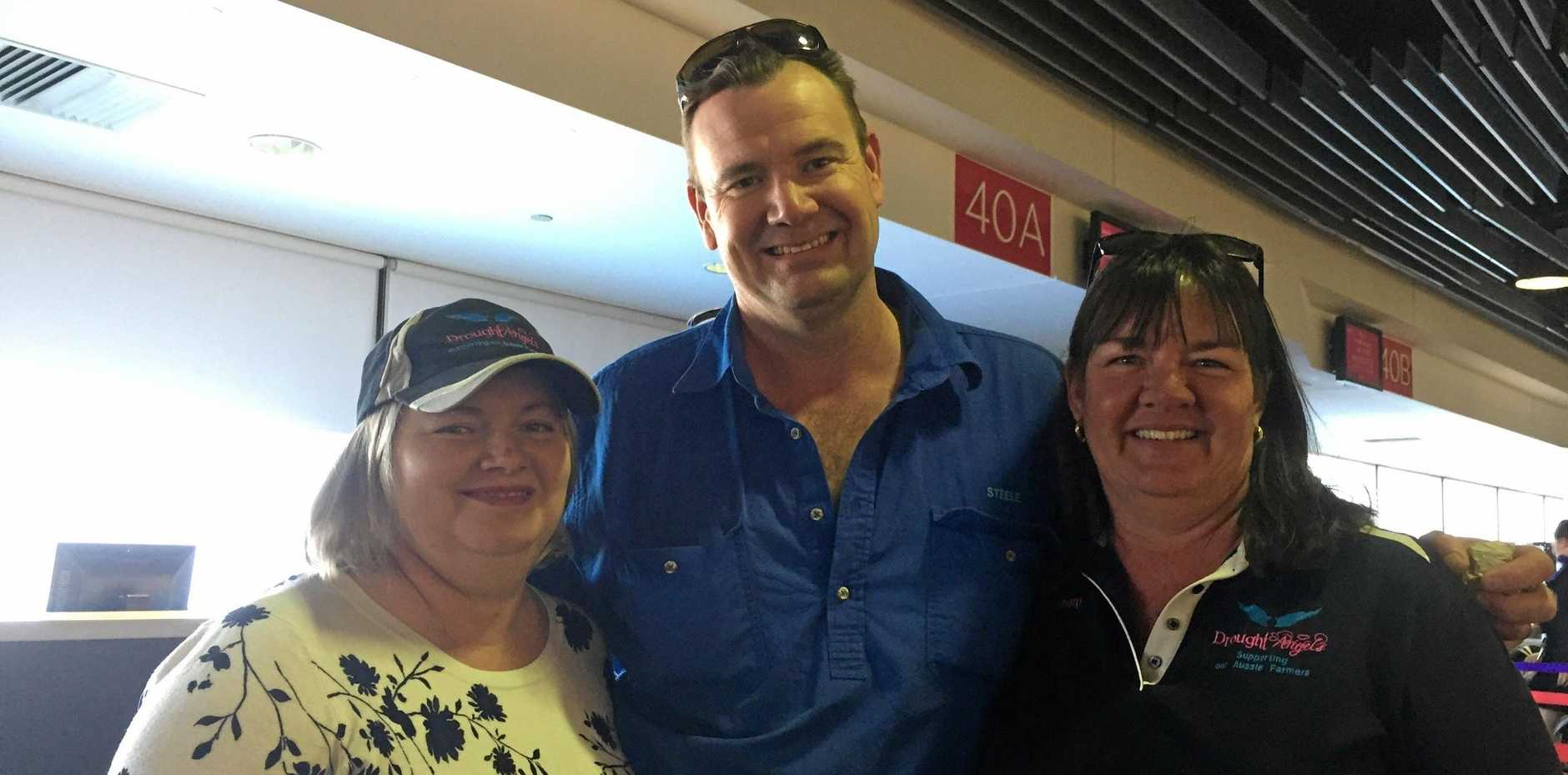 SMALL CHARITY, BIG HEART: Drought Angels Tash and Steele Johnston and Jenny Gailey ready to take off for Sydney.
