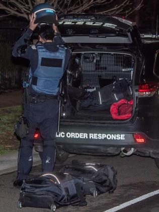 Police wore riot gear for protection. Picture: Jason Edwards