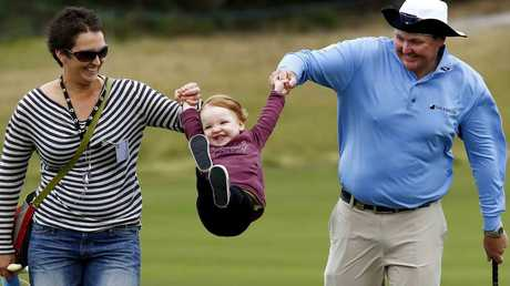 Jarrod Lyle walks the fairways with wife Briony and daughter Lush at an Australian Masters practice day in 2013. Picture: Michael Klein.