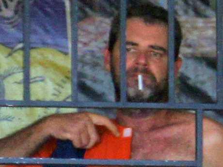 Australian Brendon Luke Johnsson, 45, arrested in Kuta. He is pictured having a smoke in his prison cell. Picture: Zul Edoardo/ News Corp Australia