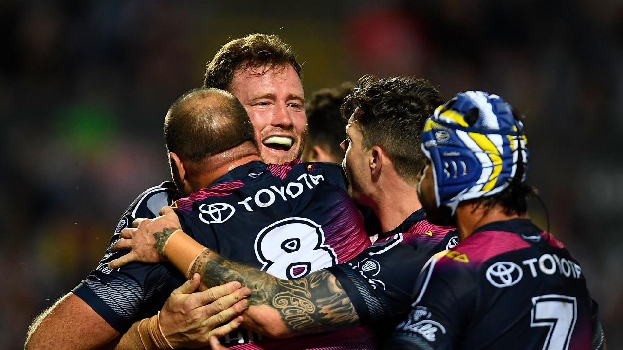 TOWNSVILLE, AUSTRALIA - AUGUST 09: Gavin Cooper of the Cowboys celebrates after scoring a try during the round 22 NRL match between the North Queensland Cowboys and the Brisbane Broncos at 1300SMILES Stadium on August 9, 2018 in Townsville, Australia. (Photo by Ian Hitchcock/Getty Images)