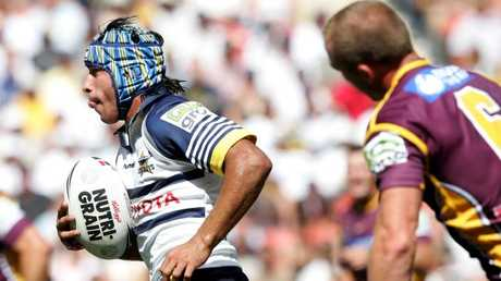 Johnathan Thurston makes a break against the Broncos in 2006.