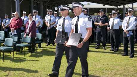 Senior constable David Ray, right, carries the memorial stone for Jeru.