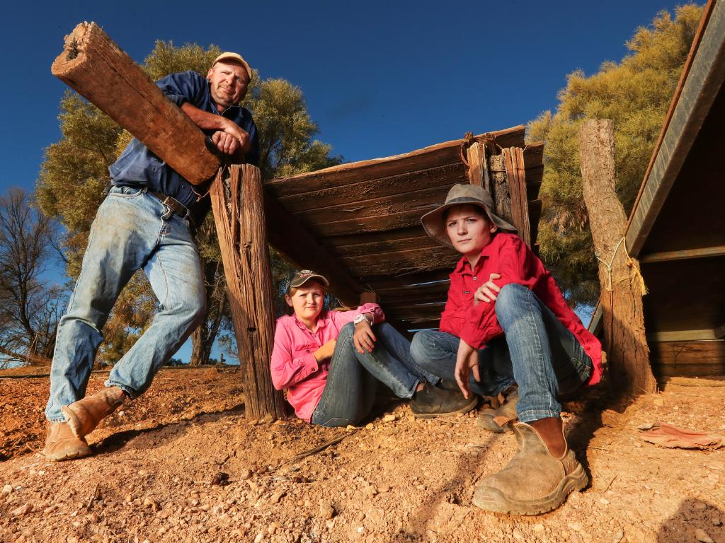 Bunginderry station's Stephen Tully with two of his four children, Harriet, 13, and Hugo, 11, on the property west of Quilpie that has been battling drought for five of the past six years. Picture: Nigel Hallett