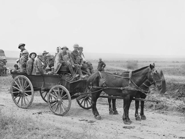 Members of the Australian 10th Infantry Brigade on their way from the fighting at what would become known as the Battle of Amiens. Picture: Australian War Memorial