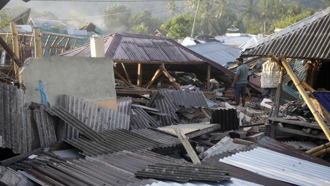 A man inspects the damage of his house destroyed by an earthquake in North Lombok, Indonesia. Picture: AP Photo/Firdia Lisnawati