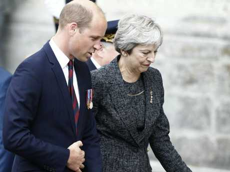 Prince William and British Prime Minister Theresa May at the service. Picture: AP