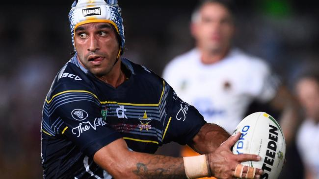 Johnathan Thurston runs the ball during a clash with the Broncos.