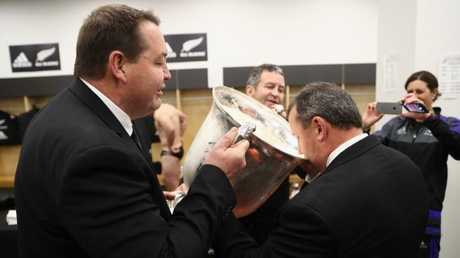 All Blacks assistant coach Ian Foster drinks from the Bledisloe Cup at Westpac Stadium.